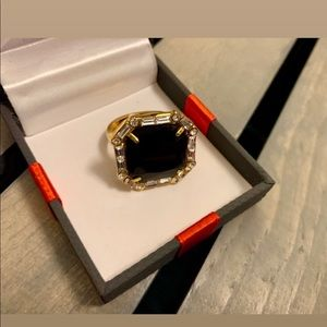 Black and gold ring